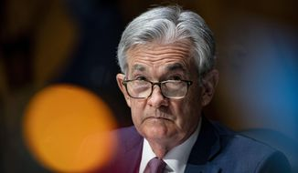"""FILE - In this Dec. 1, 2020, file photo, Federal Reserve Chair Jerome Powell listens during a Senate Banking Committee hearing on Capitol Hill in Washington. During an interview broadcast Sunday, April 11, 2021, on CBS' """"60 Minutes,"""" Powell said the U.S. economy is poised for an extended period of strong growth and hiring, though the coronavirus still poses some risk. (Al Drago/The New York Times via AP, Pool, File)"""