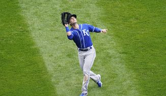 Kansas City Royals left fielder Andrew Benintendi catches a fly ball by Chicago White Sox's Luis Robert during the fourth inning of a baseball game in Chicago, Sunday, April 11, 2021. (AP Photo/Nam Y. Huh)