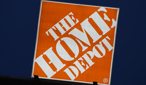 A sign advertising for The Home Depot shines over the outfield at Truist Park during a baseball game between the Philadelphia Phillies and the Atlanta Braves Monday, April 12, 2021, in Atlanta. (AP Photo/John Bazemore)
