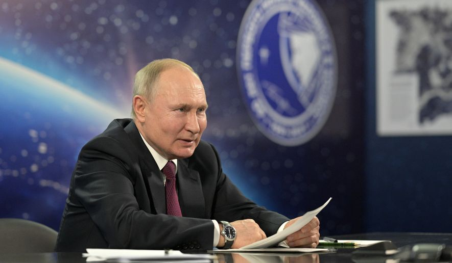 Russian President Vladimir Putin speaks visiting a memorial park on the site of Yuri Gagarin's landing after the first human spaceflight near Engels district of Saratov region, Russia, Monday, April 12, 2021. Gagarin's 108-minute flight to orbit on April 12, 1961 has been celebrated as a national triumph ever since. (Alexei Druzhinin, Sputnik, Kremlin Pool Photo via AP)