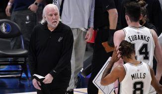 San Antonio Spurs head coach Gregg Popovich calls a time out during an NBA basketball game against the Dallas Mavericks in Dallas, Sunday, April 11, 2021. (AP Photo/Tony Gutierrez)
