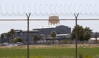 FILE - This July 23, 2014, file photo, shows a state prison in Florence, Ariz. Three Arizona officials are seeking to be dismissed from a lawsuit filed by a corrections officer who alleged that she was subjected to a hostile environment at the Florence prison where her former supervisor, Jason McClelland, was accused of sexually assaulting her and three others who worked there. McClelland has pleaded not guilty to sexual assault and other charges. (AP Photo/File)
