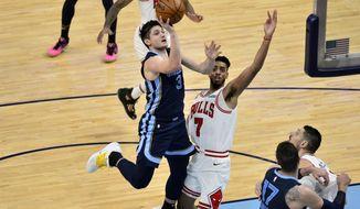 Memphis Grizzlies guard Grayson Allen (3) shoots against Chicago Bulls forward Troy Brown Jr. (7) in the second half of an NBA basketball game Monday, April 12, 2021, in Memphis, Tenn. (AP Photo/Brandon Dill)