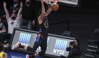 New York Knicks forward Obi Toppin (1) dunks against the Los Angeles Lakers in the second quarter of an NBA basketball game at Madison Square Garden in New York, Monday, April 12, 2021. (Wendell Cruz/Pool Photo via AP)