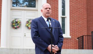 Maryland Gov. Larry Hogan talks to reporters at the governor's residence on the last day of the state's legislative session on Monday, April 12, 2021, in Annapolis, Md. Hogan, a Republican, praised bipartisan cooperation on pandemic relief legislation and on an agreement on how to allocate $3.9 billion in federal relief. (AP Photo/Brian Witte) **FILE**