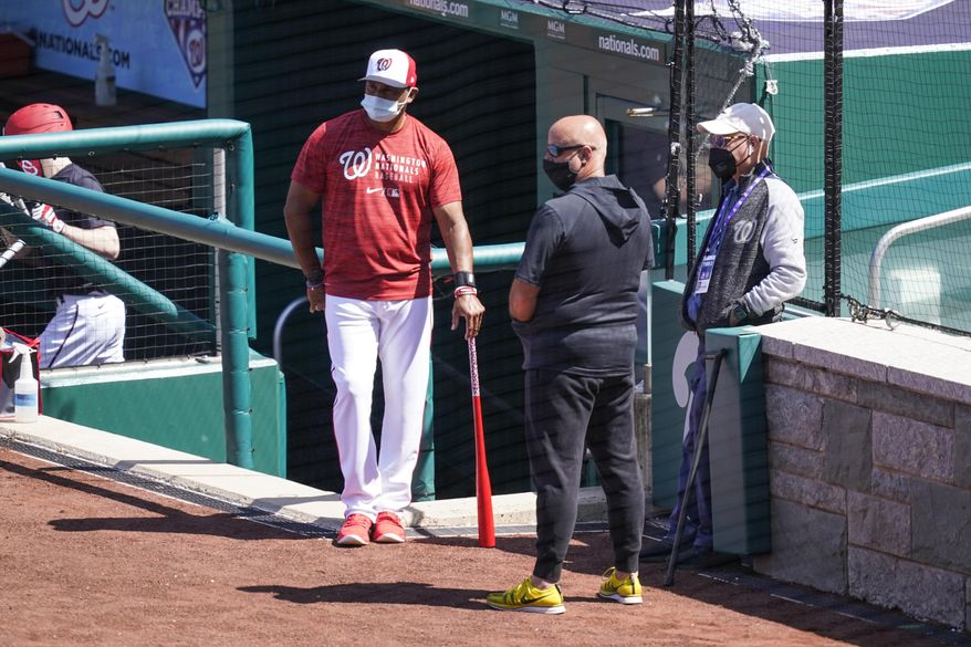 Washington Nationals manager Dave Martinez, left, general manager Mike Rizzo, and owner Mark Lerner watch the team during a baseball workout at Nationals Park, Monday, April 5, 2021, in Washington. The Nationals are scheduled to play the Braves on Tuesday. (AP Photo/Alex Brandon) **FILE**
