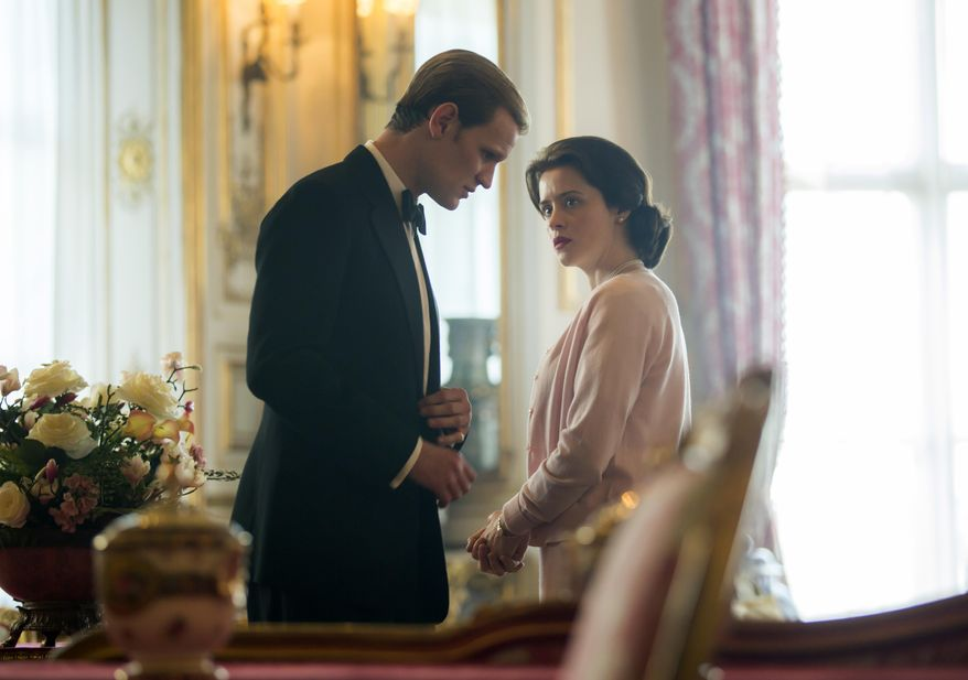 """In this image released by Netflix, Claire Foy as Queen Elizabeth II, right, and Matt Smith as Prince Philip in a scene from """"The Crown."""" Britain's Prince Philip stood loyally behind behind Queen Elizabeth, as his character does on Netflix's """"The Crown."""" But how closely does the TV character match the real prince, who died Friday, April 9, 2021 at 99? Philip is depicted as a man of action in """"The Crown,"""" and he served with distinction in the navy in World War II. He was also an avid yachtsman and polo player. (Robert Viglasky/Netflix via AP)"""