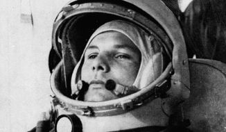 FILE - In this undated file photo, Soviet cosmonaut Major Yuri Gagarin, first man to orbit the earth, is shown in his space suit. Soviet cosmonaut Yuri Gagarin became the first human in space 60 years ago. The successful one-orbit flight on April 12, 1961 made the 27-year-old Gagarin a national hero and cemented Soviet supremacy in space until the United States put a man on the moon more than eight years later. (AP Photo/File)