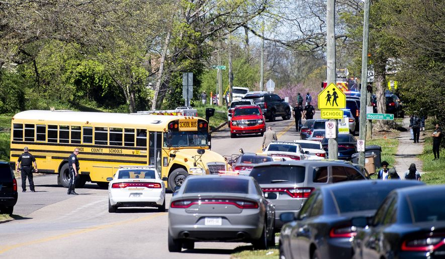Police work in the area of Austin-East Magnet High School after a reported shooting Monday, April 12, 2021. Authorities say multiple people including a police officer have been shot at the school. (Brianna Paciorka/Knoxville News Sentinel via AP)