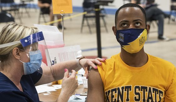Kent State University student Marz Anderson gets his Johnson & Johnson COVID-19 vaccination from Kent State nurse Beth Krul in Kent, Ohio, Thursday, April 8, 2021.  (AP Photo/Phil Long) ** FILE **