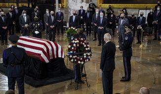 """President Joe Biden pays respects to slain U.S. Capitol Police officer William """"Billy"""" Evans as he lies in honor at the Capitol in Washington, Tuesday, April 13, 2021. (Amr Alfiky/The New York Times via AP, Pool)"""