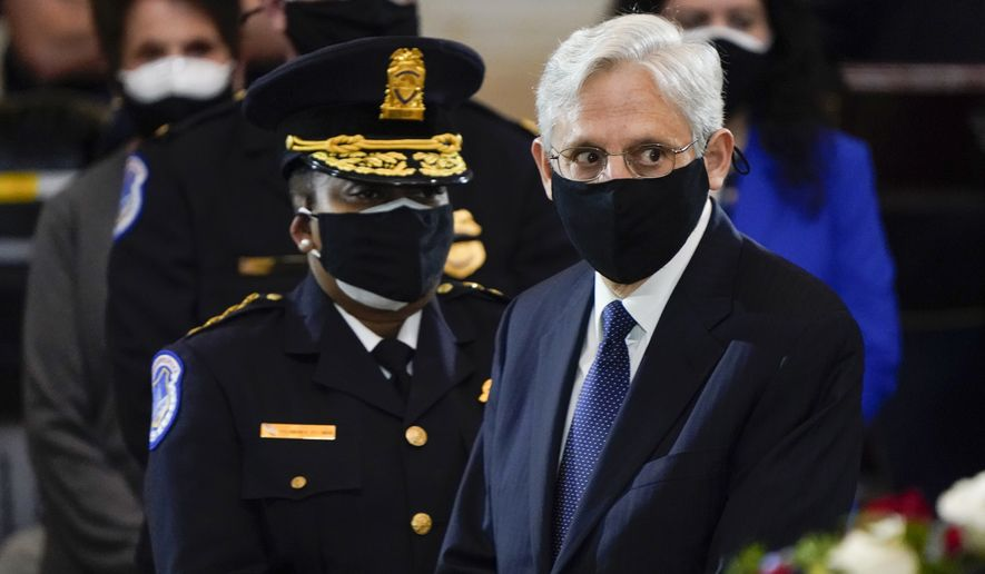 """Attorney General Merrick Garland and acting U.S. Capitol Police chief Yogananda Pittman attend a service for slain U.S. Capitol Police officer William """"Billy"""" Evans who lies in honor at the Capitol in Washington, Tuesday, April 13, 2021. (AP Photo/J. Scott Applewhite, Pool) ** FILE **"""