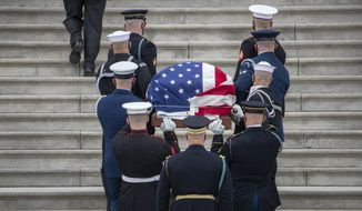 """The flag-draped casket of U.S. Capitol Police officer William """"Billy"""" Evans, arrives to lie in honor at the U.S. Capitol, Tuesday, April 13, 2021 at the U.S. Capitol in Washington. (Shawn Thew/Pool via AP)"""