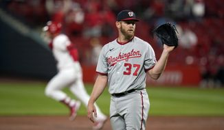 Washington Nationals starting pitcher Stephen Strasburg (37) waits for a new ball as St. Louis Cardinals' Nolan Arenado rounds the bases after hitting a two-run home run during the third inning of a baseball game Tuesday, April 13, 2021, in St. Louis. (AP Photo/Jeff Roberson)