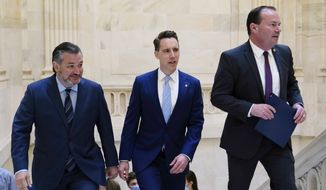Sen. Ted Cruz, R-Texas, left, Sen. Josh Hawley, R-Mo., center, and Sen. Mike Lee, R-Utah, right, arrive to talk about legislation to end Major League Baseball's special immunity from antitrust laws during a news conference on Capitol Hill in Washington, Tuesday, April 13, 2021. (AP Photo/Susan Walsh)  **FILE**