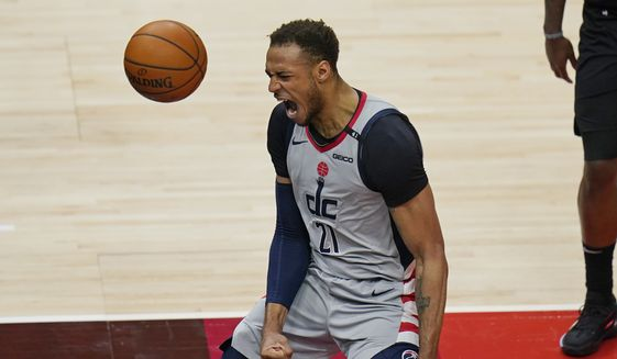 Washington Wizards center Daniel Gafford (21) reacts after making a dunk against the Utah Jazz in the second half during an NBA basketball game Monday, April 12, 2021, in Salt Lake City. (AP Photo/Rick Bowmer) **FILE**