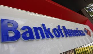 Bank of America signage is shown Wednesday, Feb. 10, 2021, in Atlanta.   The nation's largest banks are expected to report big profits for the first quarter, Tuesday, April 13,  amid renewed confidence that pandemic-battered consumers and businesses can repay their debts and start borrowing again(AP Photo/John Bazemore)