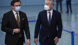 NATO Secretary General Jens Stoltenberg, right, speaks with Ukraine's Foreign Minister Dmytro Kuleba prior to a meeting at NATO headquarters in Brussels, Tuesday, April 13, 2021. (AP Photo/Francisco Seco, Pool)