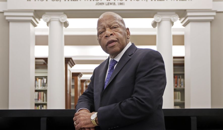 """FILE - This Nov. 18, 2016 file photo shows Rep. John Lewis, D-Ga., in the Civil Rights Room in the Nashville Public Library in Nashville, Tenn.  Some last thoughts from Lewis will be published this summer. Grand Central Publishing announced Tuesday that Lewis' """"Carry On: Reflections for a New Generation"""" will come out July 13, almost a year after he died at age 80. (AP Photo/Mark Humphrey, File)"""