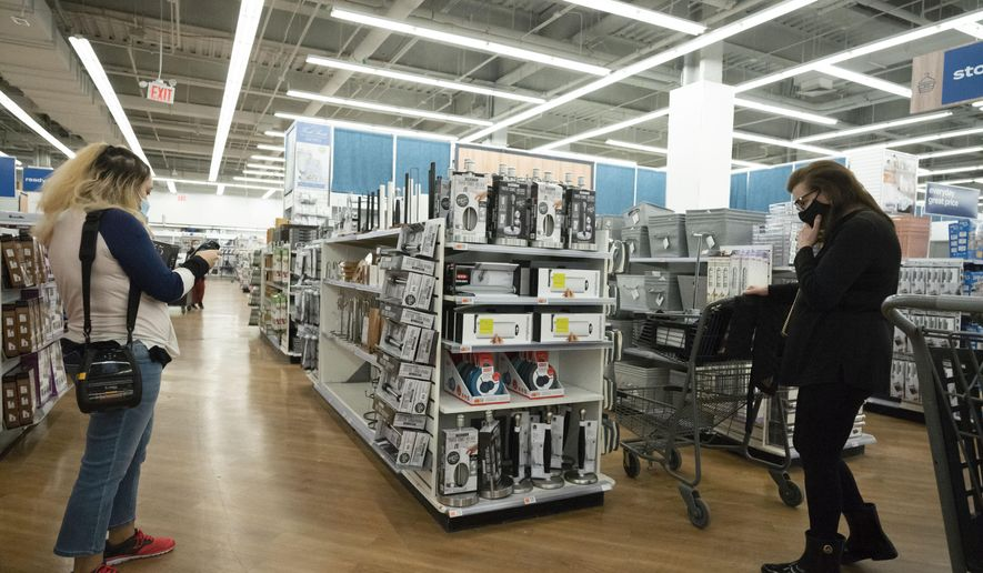 In this March 25, 2021, file photo, shoppers look at items in Bed, Bath and Beyond, in New York. U.S. consumer prices increased a sharp 0.6% in March, the biggest increase since 2012, while inflation over the past year rose a sizable 2.6%. The big gains were expected to be a temporary blip and not a sign that long dormant inflation pressures were emerging. (AP Photo/Mark Lennihan, File)
