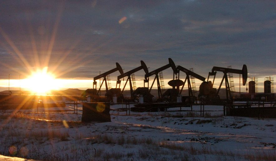 FILE - This Jan. 14, 2015 file photo shows oil pump jacks in McKenzie County in western North Dakota. Dozens of European lawmakers, business executives and union leader called Tuesday for the United States to cut its greenhouse gas emissions by 50% in the coming decade compared with 2005 levels. (AP Photo/Matthew Brown, File)