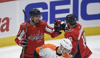 Washington Capitals left wing Conor Sheary (73) celebrates his goal with right wing Daniel Sprong (10) during the first period of an NHL hockey game, next to Philadelphia Flyers defenseman Shayne Gostisbehere (53), Tuesday, April 13, 2021, in Washington. (AP Photo/Nick Wass) **FILE**