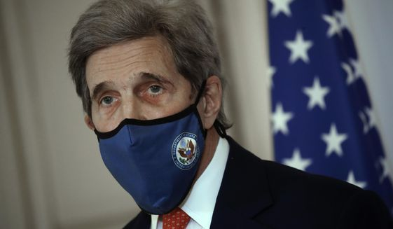 """U.S. special envoy for climate John Kerry attends a press conference with French Environment Minister Barbara Pompili Thursday, March 11, 2021 in Paris. John Kerry on Wednesday called on the world's biggest polluters to make """"key decisions"""" in the coming months that would rein in climate change. Kerry discussed preparations for a U.S.-hosted climate summit Apr. 22-23 that will virtually gather the leader of twenty countries that pump out 81% of the world's greenhouse gas emissions. (AP Photo/Christophe Ena)"""