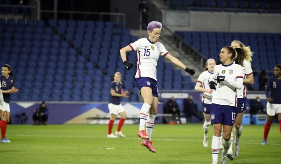 United States' Megan Rapinoe (15) celebrates after scoring on a penalty kick during the first half of an international friendly women's soccer match between the United States and France in Le Havre, France, Tuesday, April 13, 2021. (AP Photo/David Vincent)