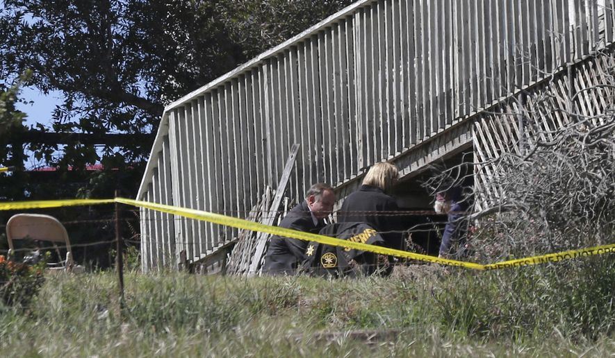 San Luis Obispo Sheriff's Office personnel dig in an area in the backyard of the home of Ruben Flores, Tuesday, March 16, 2021, in Arroyo Grande, Calif. Flores is the father of Paul Flores, who remains the prime suspect in the disappearance of Kristin Smart in 1996. (AP Photo/Daniel Dreifuss)