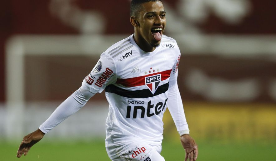 FILE - Brenner of Brazil's Sao Paulo celebrates after scoring his side's second goal during a Copa Sudamericana soccer match against Argentina's Lanus at La Fortaleza Stadium in Buenos Aires, Argentina, in this Wednesday, Oct. 28, 2020, file photo. FC Cincinnati also has a potential young star to build around. Brenner, a 21-year-old Brazilian forward, was the big offseason signing by Cincinnati. (Agustin Marcarian/Pool via AP, File)
