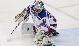 New York Rangers goaltender Igor Shesterkin (31) makes a save during the second period of an NHL hockey game against the New Jersey Devils, Tuesday, April 13, 2021, in Newark, N.J. (AP Photo/Kathy Willens)