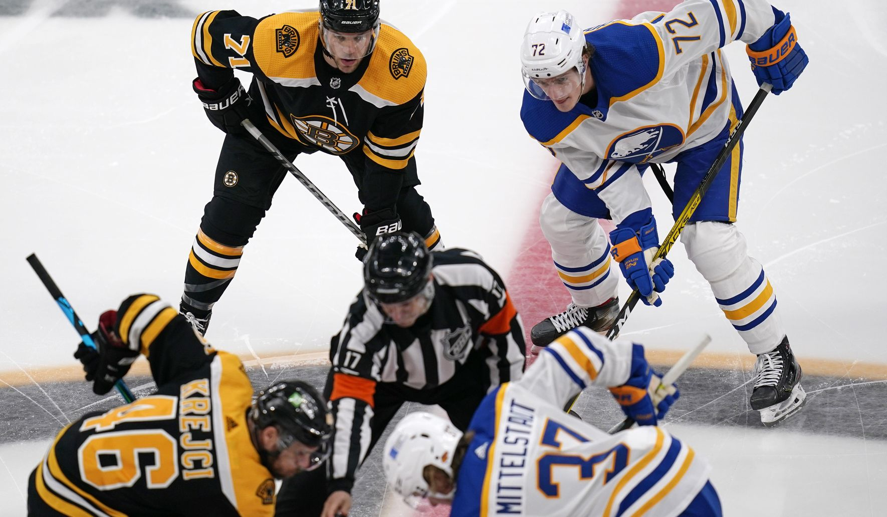 Bruins beat Sabres 3-2 in shootout in Hall's debut