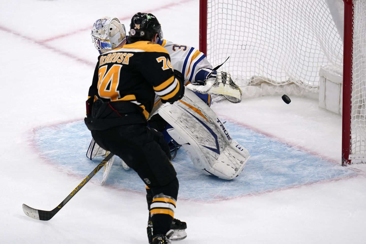 Bruins outlast Sabres in SO in Hall's debut