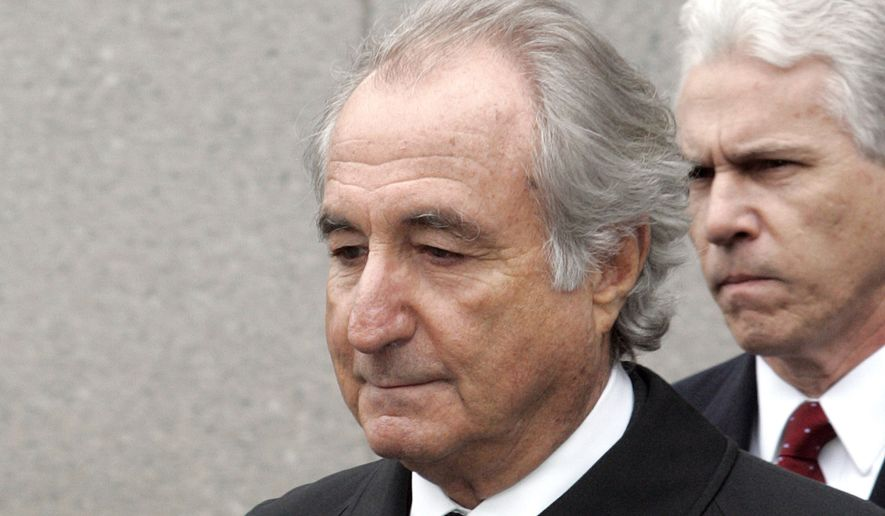 In this March 10, 2009, photo, former financier Bernie Madoff leaves federal court in Manhattan, in New York. Madoff, the financier who pleaded guilty to orchestrating the largest Ponzi scheme in history, has died in prison, a person familiar with the matter tells The Associated Press. (AP Photo/David Karp) **FILE**