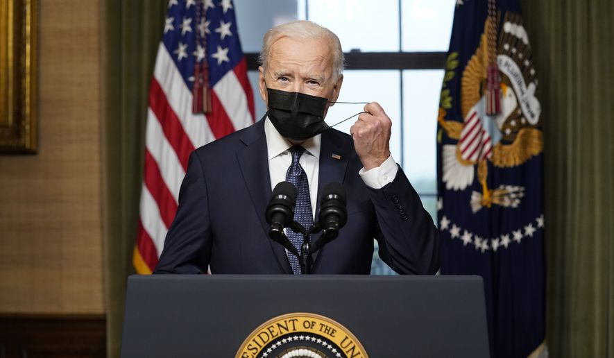 President Joe Biden removes his face mask as he speaks from the Treaty Room in the White House on Wednesday, April 14, 2021, about the withdrawal of the remainder of U.S. troops from Afghanistan. (AP Photo/Andrew Harnik, Pool) ** FILE **