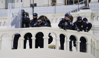 In this Jan. 6, 2021, file photo, police keep a watch on demonstrators who tried to break through a police barrier at the Capitol in Washington. A blistering internal report by the U.S. Capitol Police describes a multitude of missteps that left the force unprepared for the Jan. 6 insurrection riot shields that shattered upon impact, expired weapons that couldn't be used, inadequate training and an intelligence division that had few set standards. (AP Photo/Julio Cortez, File)