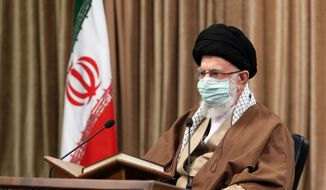 "In this picture released by an official website of the office of the Iranian supreme leader, Supreme Leader Ayatollah Ali Khamenei wearing a protective face mask, attends a meeting in Tehran, Iran, Wednesday, April 14, 2021. Khamenei said Wednesday that the offers being made at the Vienna talks over his country's tattered nuclear deal ""are not worth looking at."" (Office of the Iranian Supreme Leader via AP)"