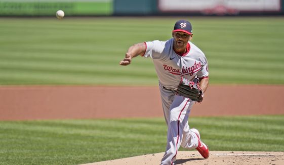 Washington Nationals starting pitcher Joe Ross throws during the first inning of a baseball game against the St. Louis Cardinals Wednesday, April 14, 2021, in St. Louis. (AP Photo/Jeff Roberson)