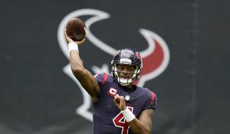 """In this Dec. 27, 2020, file photo, Houston Texans quarterback Deshaun Watson throws a pass during an NFL football game against the Cincinnati Bengals in Houston. One of the 22 women who have filed lawsuits accusing Watson of sexual assault and harassment has dropped her case, citing privacy and security concerns after some of the women were ordered to make their names public following court hearings recently. In court documents filed late Tuesday, April 13, 2021, the woman's attorney, Tony Buzbee, said she """"reserves the right to refile the case once such concerns are addressed."""" (AP Photo/Matt Patterson, File) **FILE**"""
