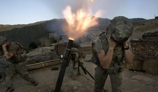 Soldiers from the U.S. Army First Battalion, 26th Infantry fire mortars from the Korengal Outpost at Taliban positions in the Korengal Valley of Afghanistan's Kunar Province on May 12, 2009. (AP Photo/David Guttenfelder) **FILE**