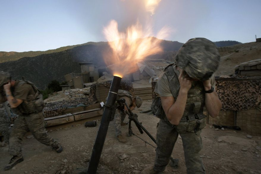 Soldiers from the U.S. Army First Battalion, 26th Infantry fire mortars from the Korengal Outpost at Taliban positions in the Korengal Valley of Afghanistan's Kunar Province on May 12, 2009. (AP Photo/David Guttenfelder) ** FILE **