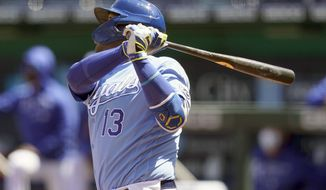 Kansas City Royals Salvador Perez hits a solo home run off Los Angeles Angels starting pitcher Griffin Canning during the third inning of a baseball game at Kauffman Stadium in Kansas City, Mo., Wednesday, April 14, 2021. (AP Photo/Orlin Wagner)