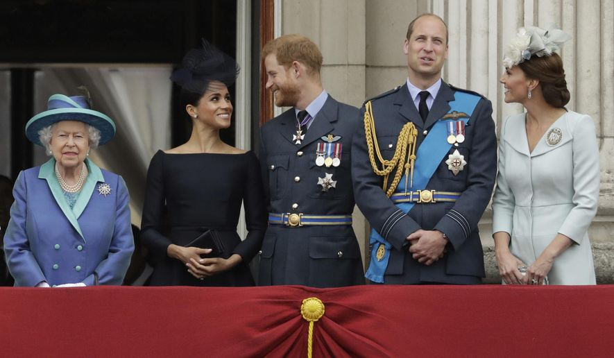 In this file photo dated Tuesday, July 10, 2018, Britain's Queen Elizabeth II, and from left, Meghan the Duchess of Sussex, Prince Harry, Prince William and Kate the Duchess of Cambridge, watch as Royal Air Force aircraft pass over Buckingham Palace in London. Prince Harry will attend the funeral for Prince Philip on Saturday, April 17, the first time that Harry will come face to face with the royal family since he and his wife Meghan, the Duchess of Sussex, stepped away from royal duties last March and moved to California with their young son, Archie.(AP Photo/Matt Dunham, File)
