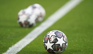 The Official UEFA Champions League match balls are on display ahead of the Champions League quarter final second leg soccer match between Liverpool and Real Madrid at Anfield stadium in Liverpool, England, Wednesday, April 14, 2021. (AP Photo/Jon Super) **FILE**
