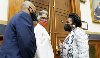 Rep. Joyce Beatty, D-Ohio, center, listens as Rep. Sheila Jackson Lee, D-Tex., right, chair of the Subcommittee on Crime, Terrorism, and Homeland Security, attends a markup in the House Judiciary Committee of a bill to create a commission to study and address social disparities in the African American community today. Rep. Jackson-Lee is the sponsor of that legislation. (AP Photo/J. Scott Applewhite)