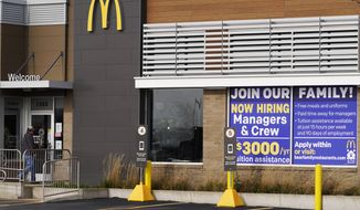 In this Nov. 19, 2020, file photo, a hiring sign is displayed outside of McDonald's in Buffalo Grove, Ill. (AP Photo/Nam Y. Huh, File)