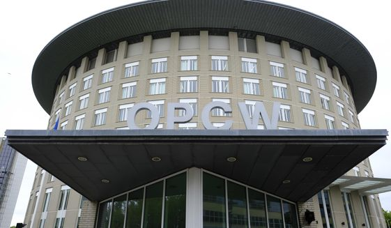 """FILE - This Friday May 5, 2017 file photo shows the headquarters of the Organisation for the Prohibition of Chemical Weapons (OPCW), The Hague, Netherlands. An investigation by the global chemical weapons watchdog found """"reasonable grounds to believe"""" that a Syrian air force military helicopter dropped a chlorine cylinder on a Syrian town in 2018, sickening 12 people, the Organization for the Prohibition of Chemical Weapons said Monday, April 12, 2021.(AP Photo/Peter Dejong, File)"""