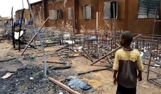 This image taken from Associated Press video, shows burnt chairs, tables and other objects in the school, in Niamey, Niger, Wednesday April 14, 2021. Hospital officials say a fire at an elementary school in Niger's capital has killed 20 children. It was not immediately known what started the fire on Tuesday afternoon but authorities said that high winds in the area allowed the blaze to spread rapidly. (AP Photo/Boureima Issoufou)