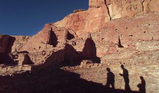 In this Nov. 21, 1996, file photo, tourists cast their shadows on the ancient Anasazi ruins of Chaco Culture National Historical Park in New Mexico. (AP Photo/Eric Draper, File)