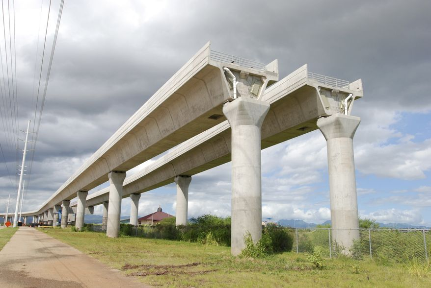 A rail line under construction stops abruptly in a field in the Honolulu suburb of East Kapolei, Hawaii. (AP Photo/Cathy Bussewitz, File)